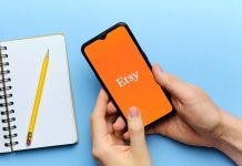 Etsy logo on phone with blue background