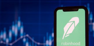 Robinhood app with stock chart background
